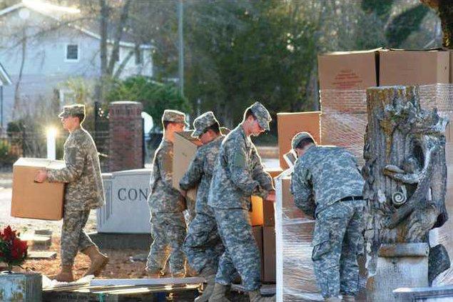 CAP Squadron 805 cadets unpack boxes of wreaths.