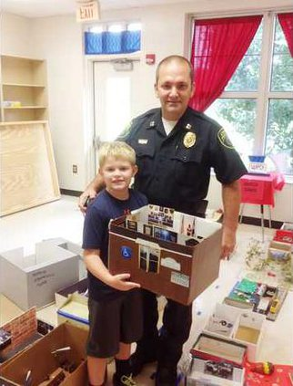 Camden Police Officer Mike Stone and 2nd Grader Cade Marturano holding a replica of the Camden Police Department - Web