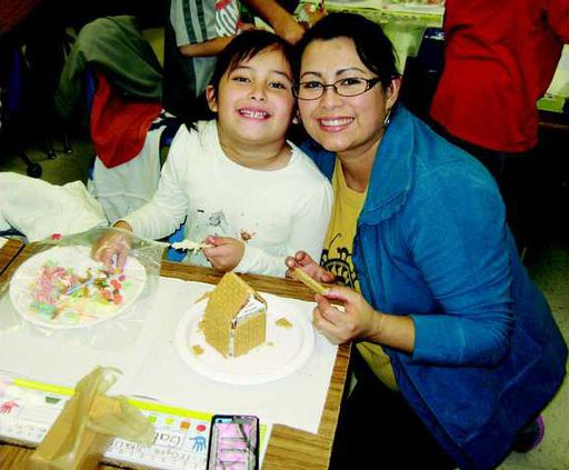 grader Gabby Aponte and her mom have fun during Gingerbread Night -T