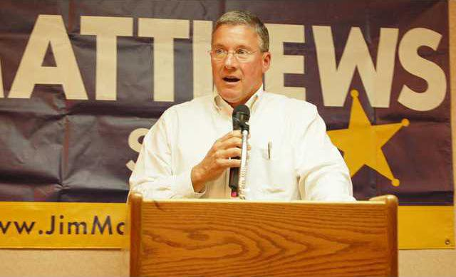 Jim Matthews at podium.JPG