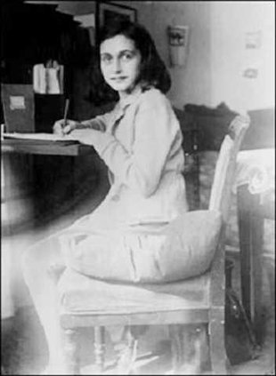 Anne Frank at her desk